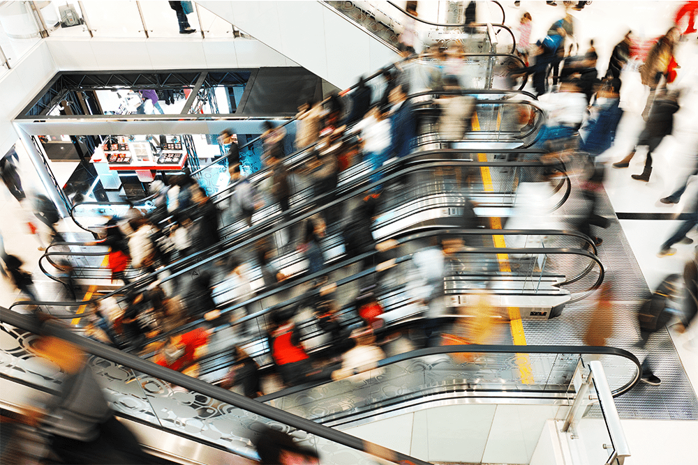 Image of people on escalator at shopping mall